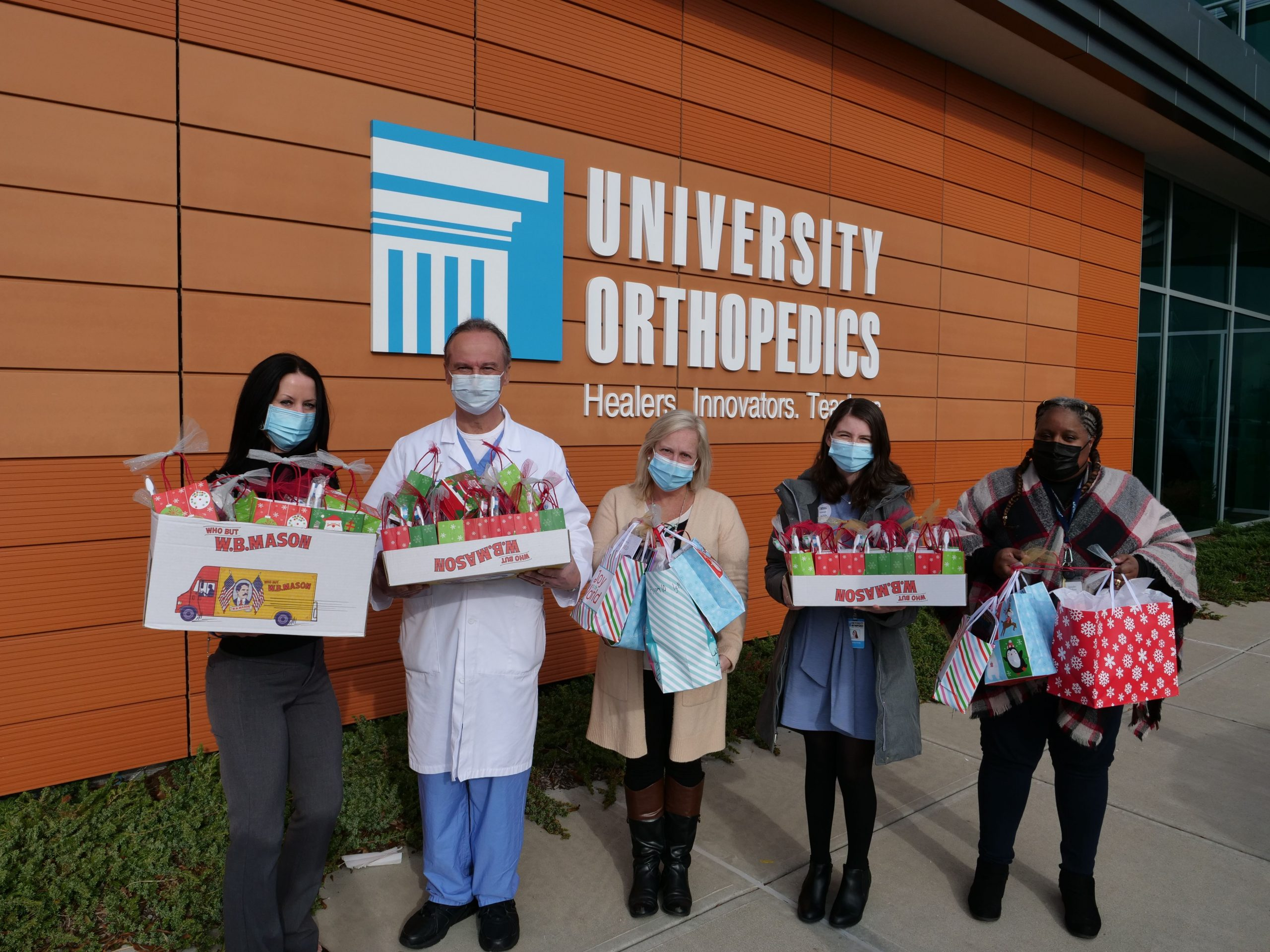 UOI's 'Season of Giving' continues with warm donation to Crossroads RI
